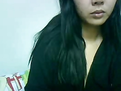 Indonesian girl with big tits playing on webcam